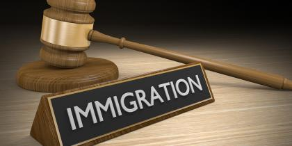 immigration tab and gavel, supreme court, travel ban