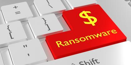 ransomware button on keyboard that costs healthcare industry milions