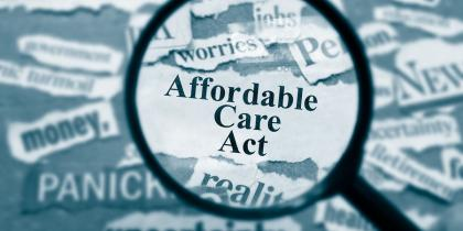Affordable Care Act ACA under magnifying glass