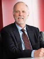J William Dockrey, Patent attorney, Brinks Gilson